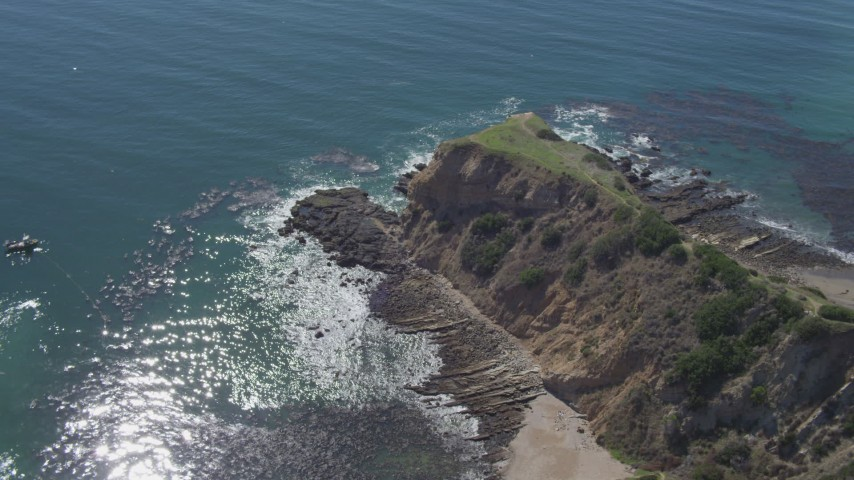 4K aerial video flyby coastal cliff to reveal small cove in Rancho Palos Verdes, California Aerial Stock Footage | DCA06_051