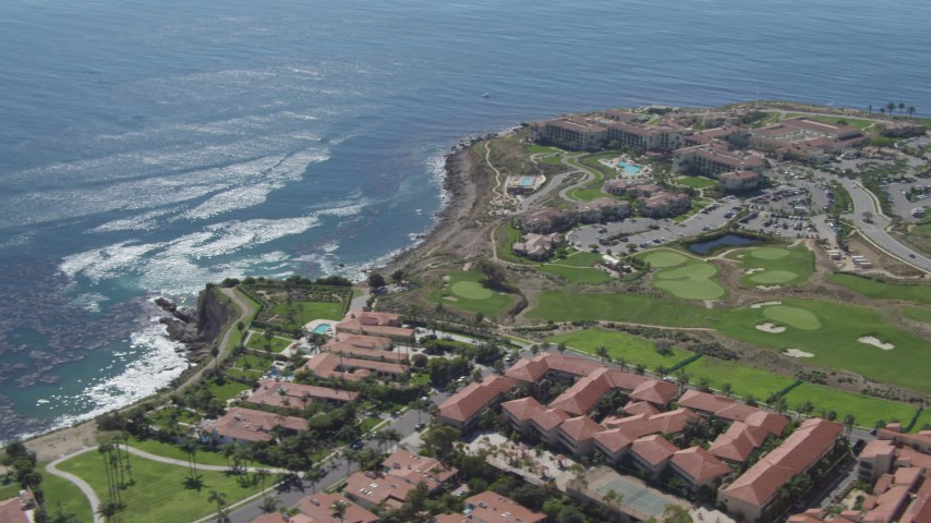 4K stock footage aerial video flyby coast, reveal to reveal a resort and a golf course at Rancho Palos Verdes, California Aerial Stock Footage | DCA06_053