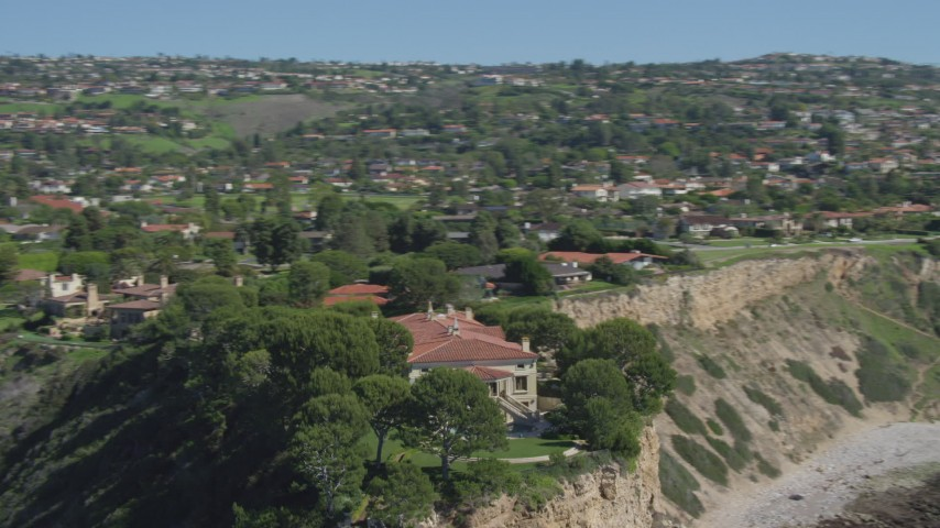 4K stock footage aerial video orbit a mansion on a cliff, overlooking ocean in Palos Verdes Estates, California Aerial Stock Footage | DCA06_057