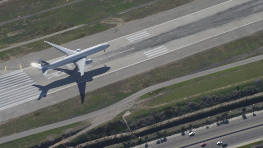 4K stock footage aerial video of a cargo jet landing at LAX (Los Angeles International Airport), Los Angeles, California Aerial Stock Footage | DCA06_062