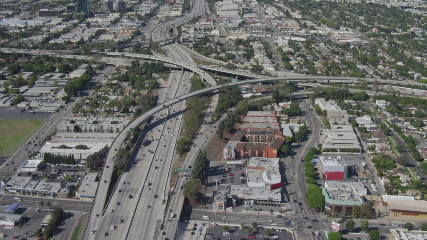 4K stock footage aerial video tilt from light traffic to reveal freeway interchange, Mar Vista, California Aerial Stock Footage | DCA06_065