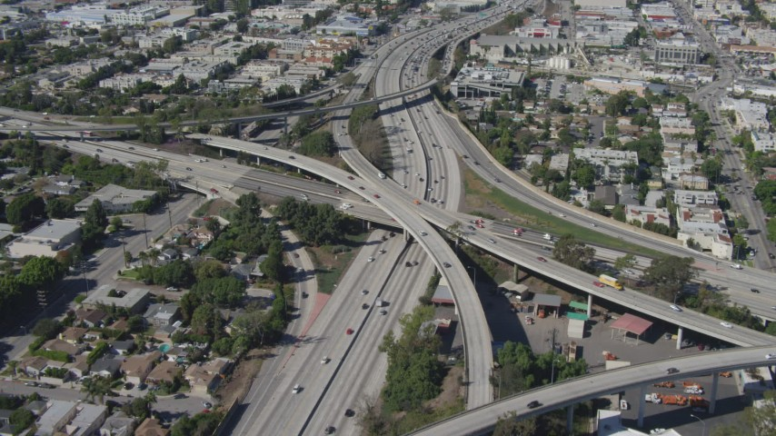 4K stock footage aerial video tilt to bird's eye view of light traffic on freeway interchange, Mar Vista, California Aerial Stock Footage | DCA06_066