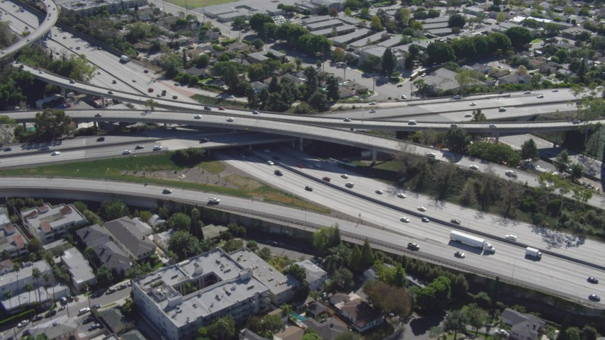 4K stock footage aerial video of flying away from Interstate 405 and Interstate 10 interchange, Mar Vista, California Aerial Stock Footage   DCA06_067