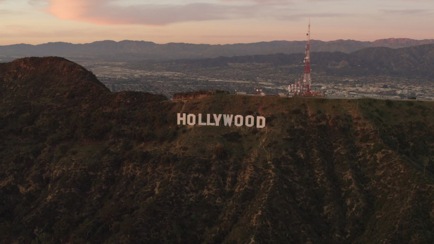4K stock footage aerial video of flying by the Hollywood Sign, Los Angeles, California, sunset Aerial Stock Footage | DCA07_002
