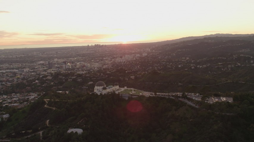 4K stock footage aerial video of orbiting the east side of the Griffith Observatory, Los Angeles, California, sunset Aerial Stock Footage | DCA07_005