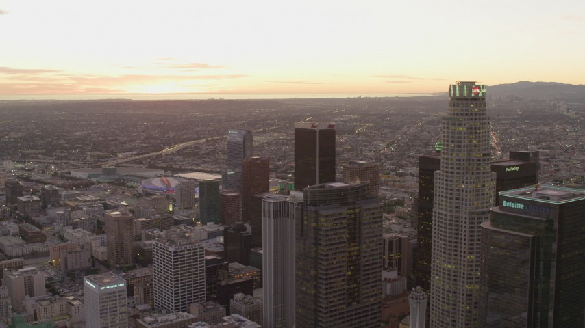 4K stock footage aerial video of flying by Downtown Los Angeles skyscrapers, California, sunset Aerial Stock Footage | DCA07_008
