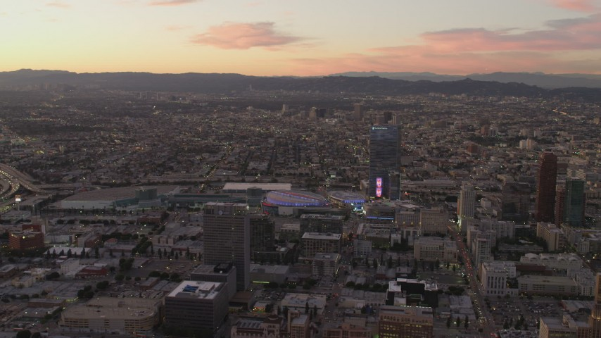 4K stock footage aerial video of flying by Staples Center, The Ritz-Carlton, Downtown buildings, Los Angeles, California, sunset Aerial Stock Footage | DCA07_009