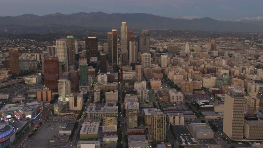 4K stock footage aerial video of flying over buildings, tilt up, reveal Downtown skyscrapers, Los Angeles, California, twilight Aerial Stock Footage | DCA07_010