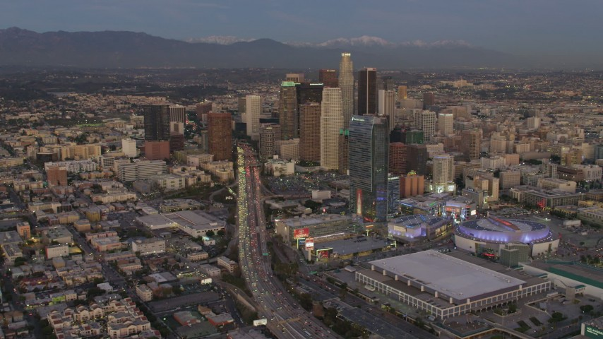 4K aerial video of flying by Highway 110, tilt up to reveal Downtown skyscrapers, Los Angeles, California, twilight Aerial Stock Footage | DCA07_015