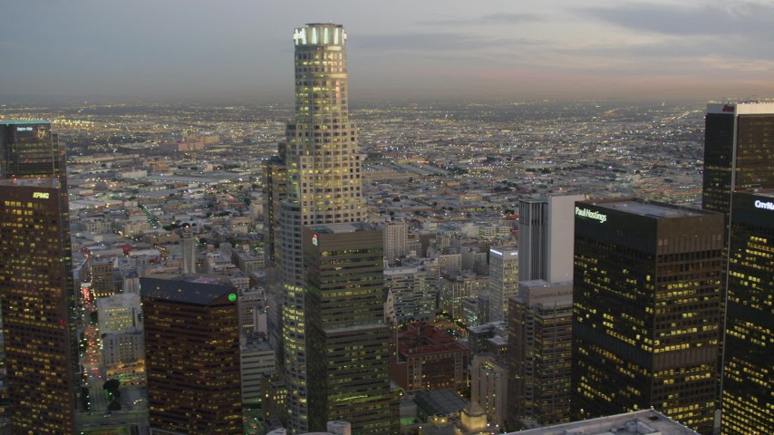 4K stock footage aerial video of flying by Downtown skyscrapers, revealing US Bank Tower, Los Angeles, California, twilight Aerial Stock Footage | DCA07_022