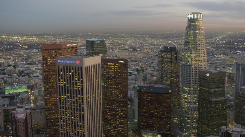 4K stock footage aerial video of flying by Downtown, revealing southeast districts, Los Angeles, California, twilight Aerial Stock Footage | DCA07_023