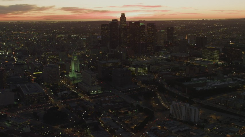 4K aerial video of approaching Los Angeles City Hall, revealing Downtown skyline, Los Angeles, California, twilight Aerial Stock Footage | DCA07_024