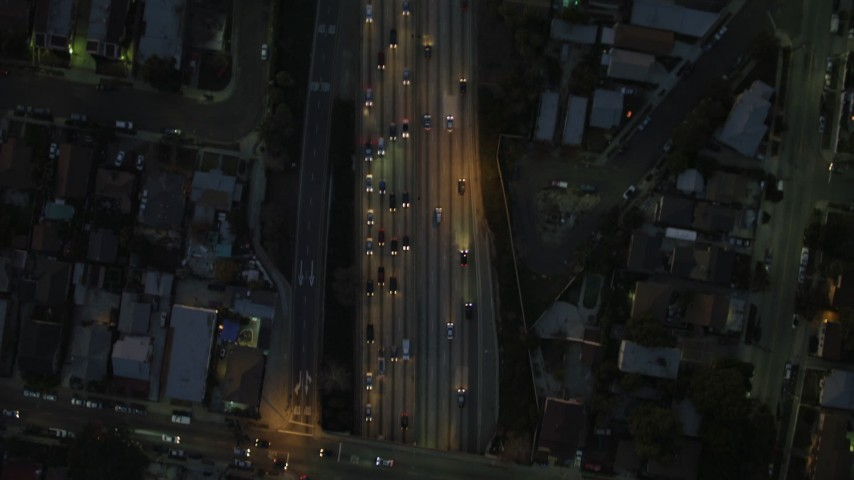 4K stock footage aerial video of bird's eye view flying over Highway 101, heavy traffic, Silverlake, California, night Aerial Stock Footage | DCA07_033
