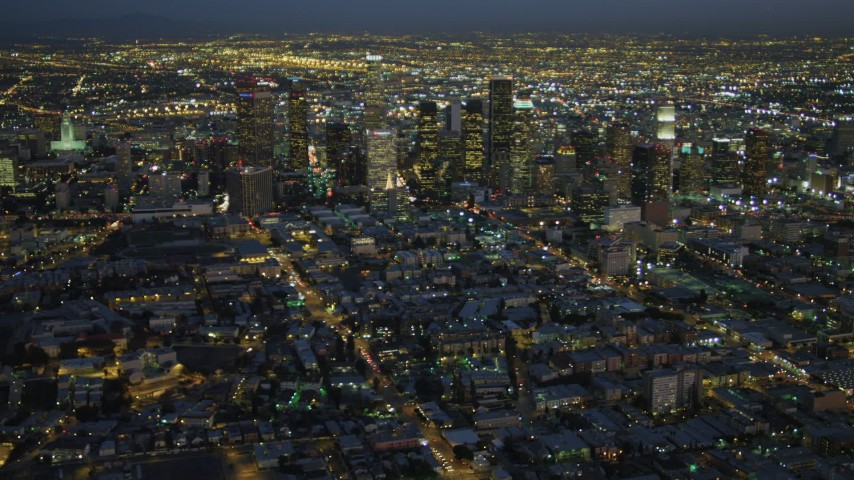 4K stock footage aerial video of approaching Downtown skyscrapers, Los Angeles, California, night Aerial Stock Footage | DCA07_035