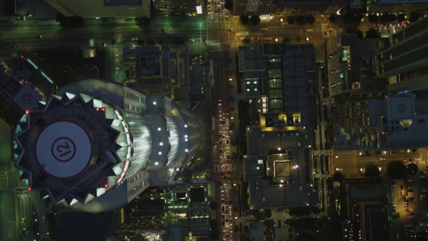4K stock footage aerial video bird's eye view flying over Westin Bonaventure Hotel, revealing Downtown skyscrapers, Los Angeles, California, night Aerial Stock Footage | DCA07_039