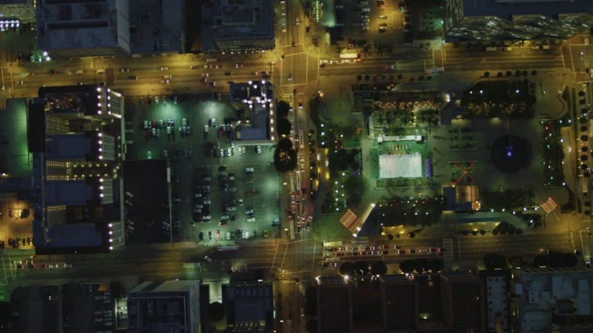 4K stock footage aerial video of bird's eye view following West 5th past Gas Company Tower, Downtown Los Angeles, California, night Aerial Stock Footage | DCA07_040