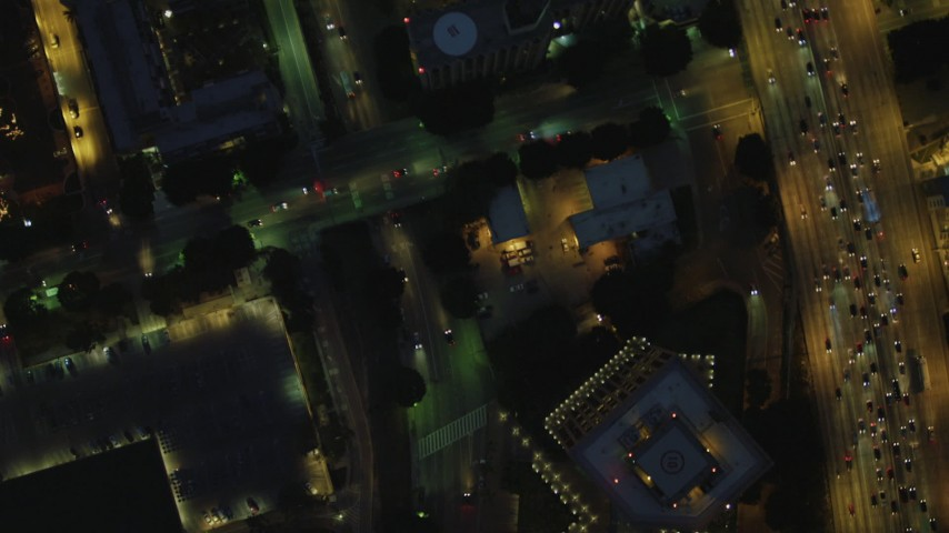 4K stock footage aerial video of bird's eye view flying between Highway 110 and North Figueroa, Downtown, Los Angeles, California, night Aerial Stock Footage | DCA07_045