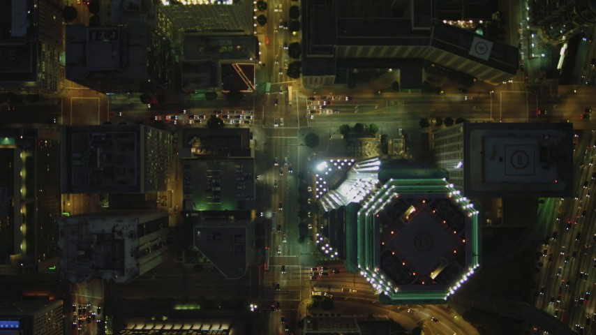 4K stock footage aerial video of bird's eye view following South Figueroa past Downtown skyscrapers, Los Angeles, California, night Aerial Stock Footage | DCA07_049