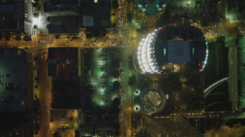 4K stock footage aerial video of bird's eye view following South Figueroa past skyscrapers, Downtown, Los Angeles, California, night Aerial Stock Footage | DCA07_050