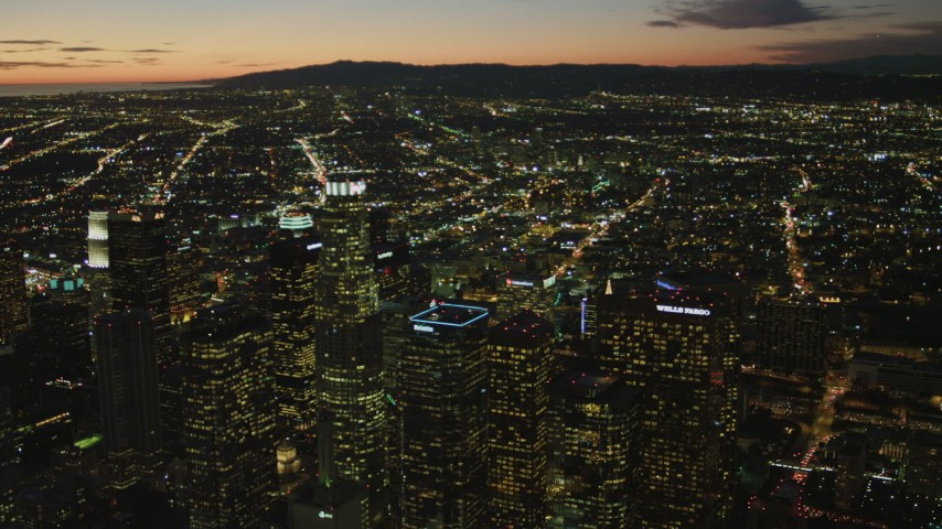 4K stock footage aerial video of flying by Downtown skyscrapers, view of Los Angeles Basin, Santa Monica Mountains, California, twilight Aerial Stock Footage | DCA07_052