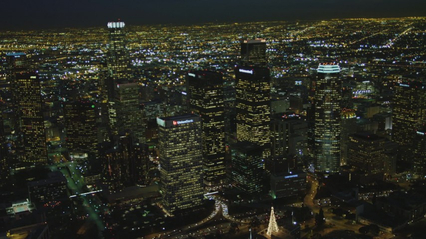 4K stock footage aerial video of flying by Downtown skyscrapers, Los Angeles, California, night Aerial Stock Footage | DCA07_055