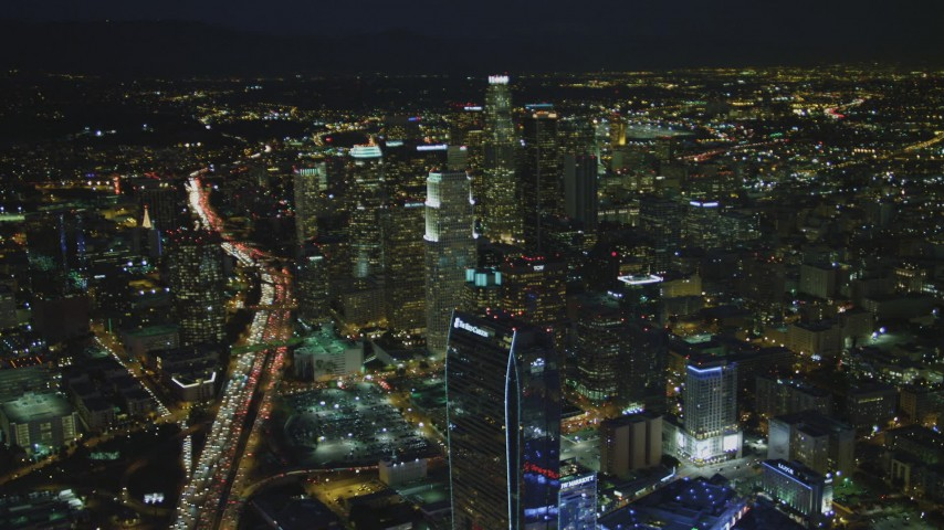 4K stock footage aerial video of The Ritz-Carlton, skyscrapers, Highway 110, Los Angeles, California, night Aerial Stock Footage | DCA07_059