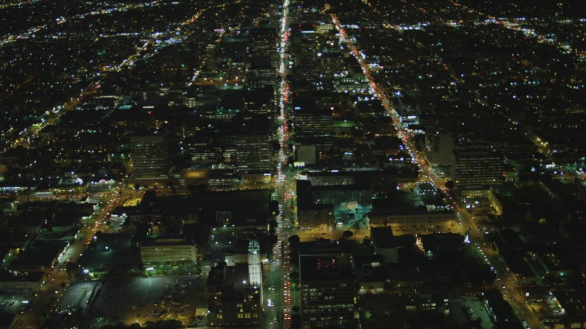 4K stock footage aerial video of following Wilshire Boulevard through Koreatown, Los Angeles, California, night Aerial Stock Footage | DCA07_065