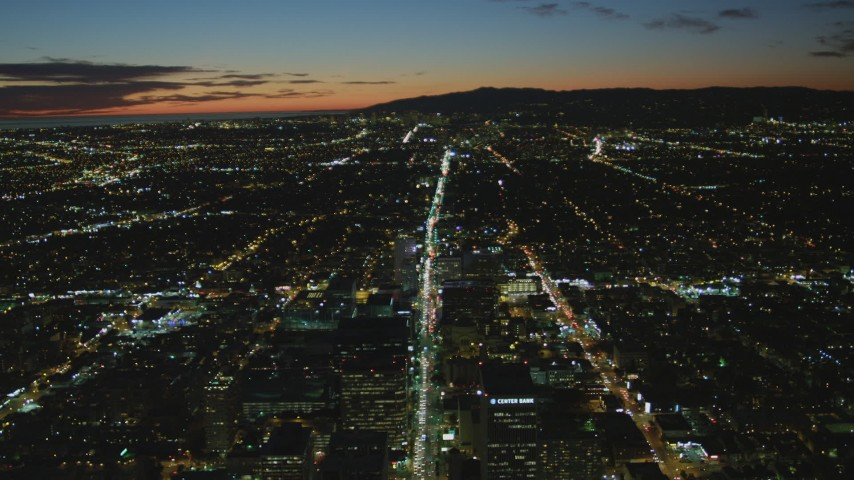 4K stock footage aerial video of following Wilshire Blvd through Koreatown to Century City, Los Angeles, California, night Aerial Stock Footage | DCA07_067
