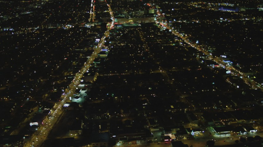 4K aerial video of flying by the Beverly Center, Beverly Hills, California, night Aerial Stock Footage | DCA07_079