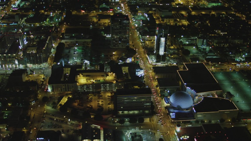 4K stock footage aerial video of following Sunset Blvd past Cinerama Dome, to North Gower Street; Hollywood, California, night Aerial Stock Footage DCA07_084 | Axiom Images