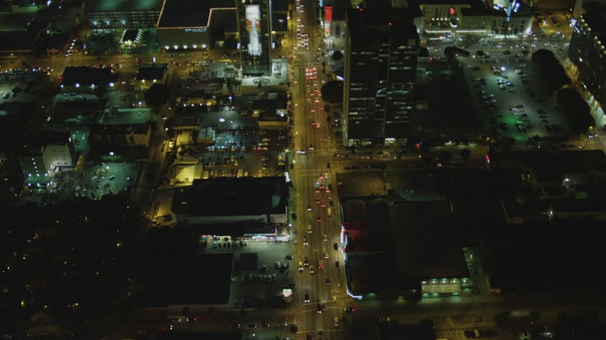 4K stock footage aerial video of following Sunset Blvd, revealing Cinerama Dome, Hollywood, California, night Aerial Stock Footage   DCA07_086