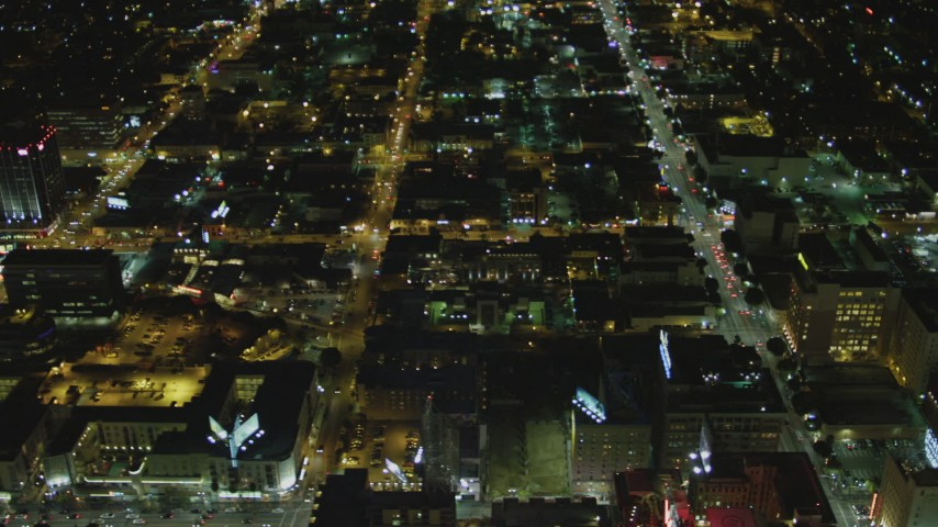 4K stock footage aerial video tilt to the intersection of Hollywood Blvd and Vine Street, Hollywood, California, night Aerial Stock Footage   DCA07_087