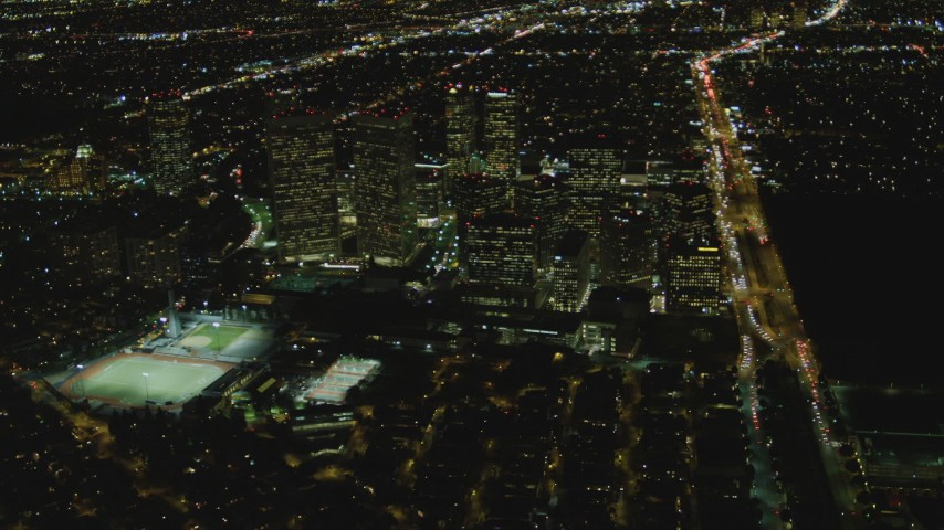 4K stock footage aerial video of approaching skyscrapers, Century City, California, night Aerial Stock Footage | DCA07_097