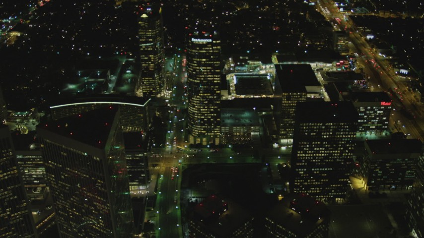 4K stock footage aerial video of approaching skyscrapers in Century City, California, night Aerial Stock Footage | DCA07_098