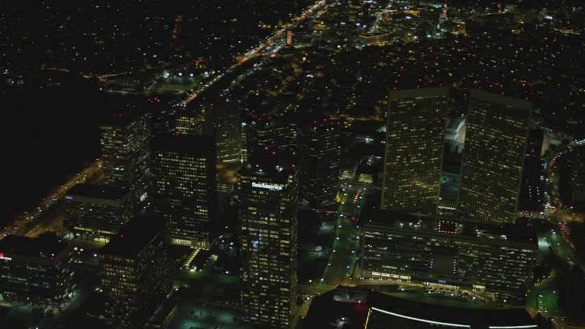 4K stock footage aerial video of flying by skyscrapers, Century City, California, night Aerial Stock Footage | DCA07_100