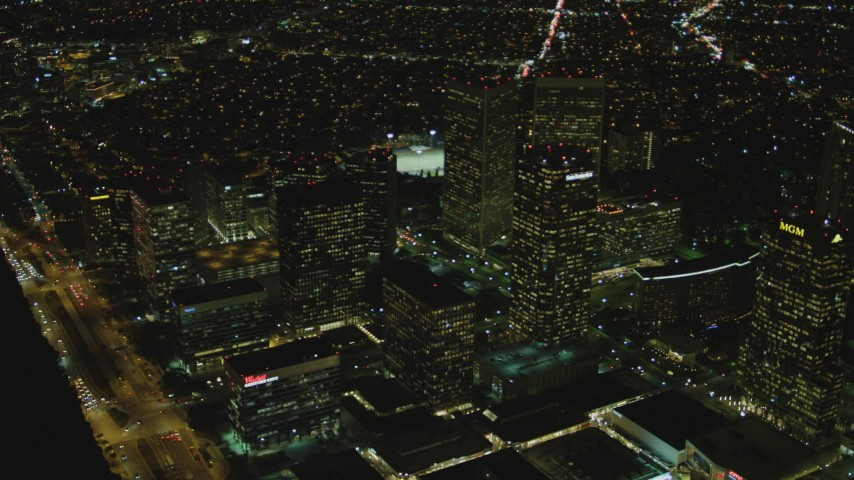 4K stock footage aerial video of flying away from skyscrapers, Century City, California, night Aerial Stock Footage | DCA07_101