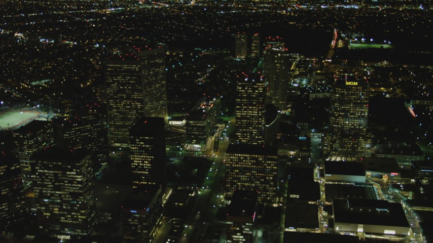 4K stock footage aerial video of flying by skyscrapers, revealing Avenue of the Stars, Century City, California, night Aerial Stock Footage | DCA07_103