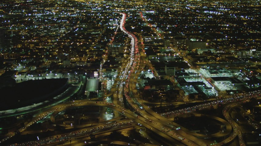 4K stock footage aerial video of approaching Interstate 110 and Interstate 10 interchange, Downtown, Los Angeles, California, night Aerial Stock Footage | DCA07_110