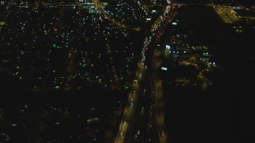4K stock footage aerial video of flying away from Interstate 710, reveal interchange with Highway 91, Long Beach, California, night Aerial Stock Footage | DCA07_120