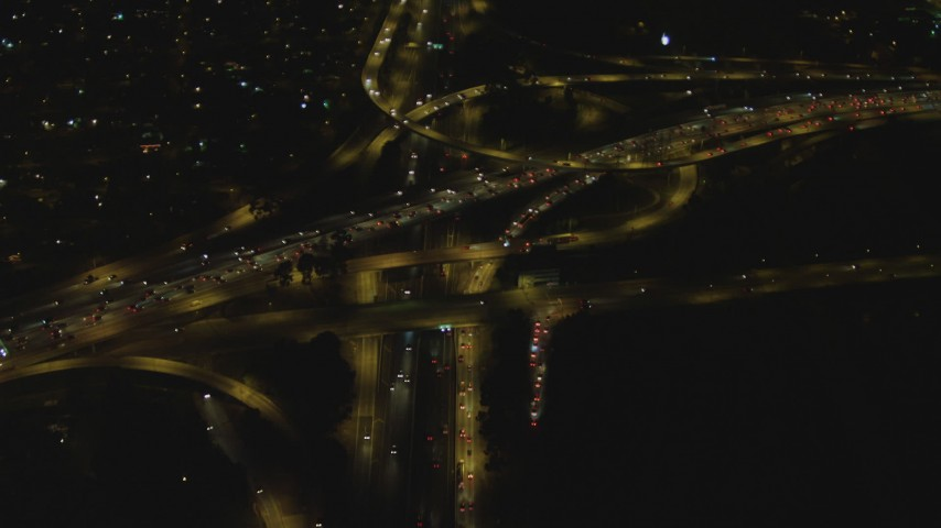 4K aerial video of flying away from Highway 91 and Interstate 710 interchange, Long Beach, California, night Aerial Stock Footage | DCA07_121
