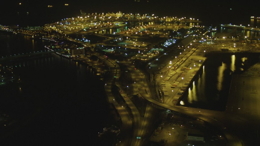 4K stock footage aerial video of panning across the Port of Long Beach, Long Beach, California, night Aerial Stock Footage | DCA07_123