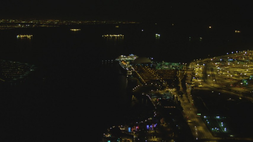 4K stock footage aerial video of RMS Queen Mary, Carnival Cruise Lines building, Port of Long Beach, California, night Aerial Stock Footage | DCA07_125