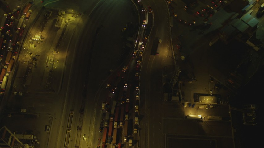 4K stock footage aerial video of flying over trucks lined up at Port of Long Beach, California, night Aerial Stock Footage | DCA07_128