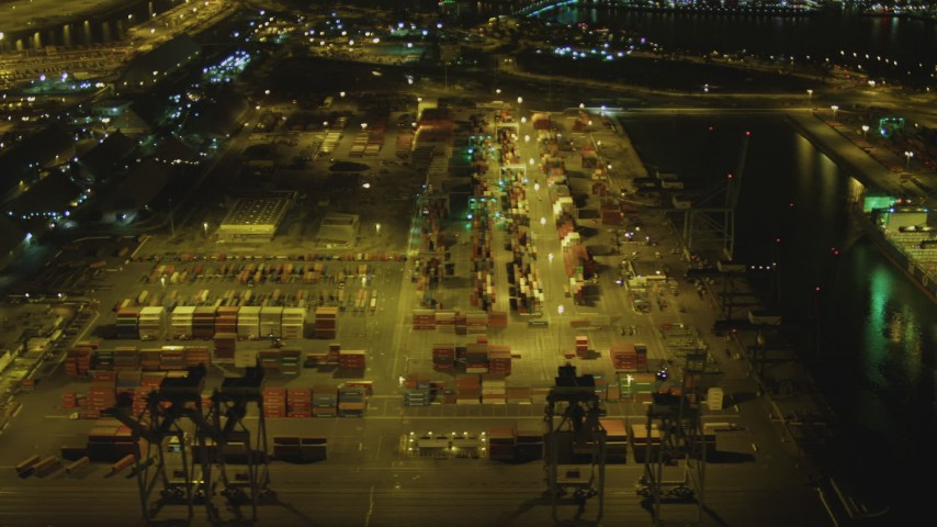 4K stock footage aerial video of flying by cargo containers, cranes, Port of Long Beach, California, night Aerial Stock Footage | DCA07_130
