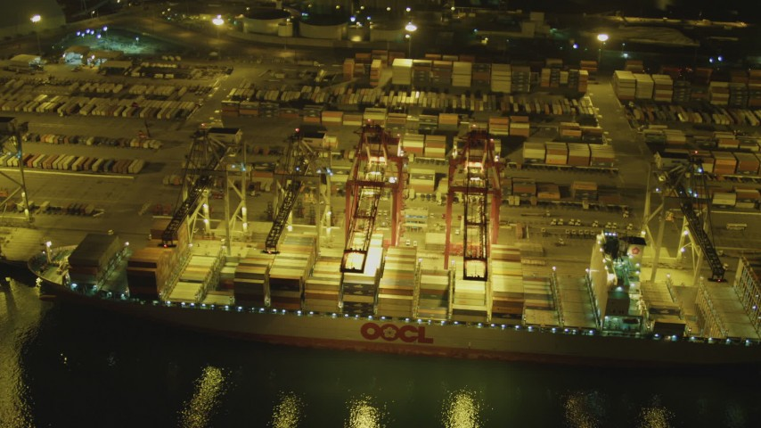 4K stock footage aerial video fly over cargo ship, cranes, containers at Port of Long Beach, California, night Aerial Stock Footage | DCA07_137