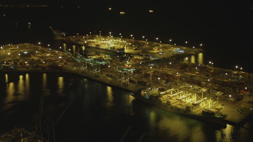4K stock footage aerial video of approaching cargo containers, cranes at the Port of Long Beach, California, night Aerial Stock Footage | DCA07_139
