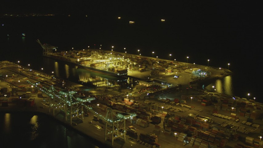 4K stock footage aerial video of approaching cargo containers, cranes, Port of Long Beach, California, night Aerial Stock Footage | DCA07_140