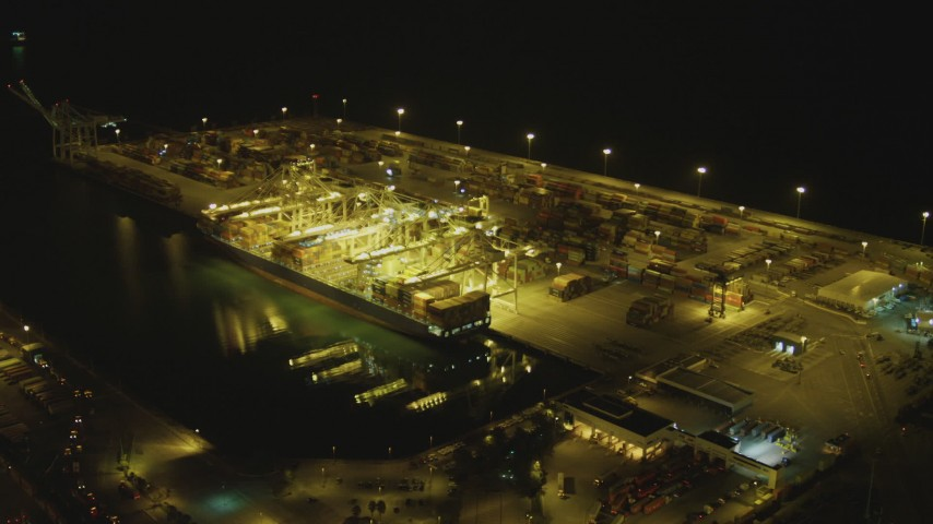 4K stock footage aerial video of approaching cargo ship and cranes, Port of Long Beach, California, night Aerial Stock Footage | DCA07_141