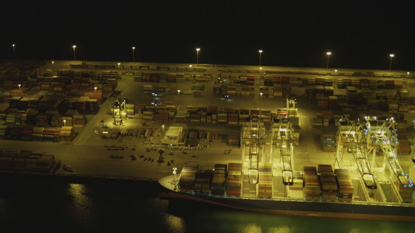 4K stock footage aerial video of flying by cargo ship, cranes and containers at Port of Long Beach, California, night Aerial Stock Footage | DCA07_142