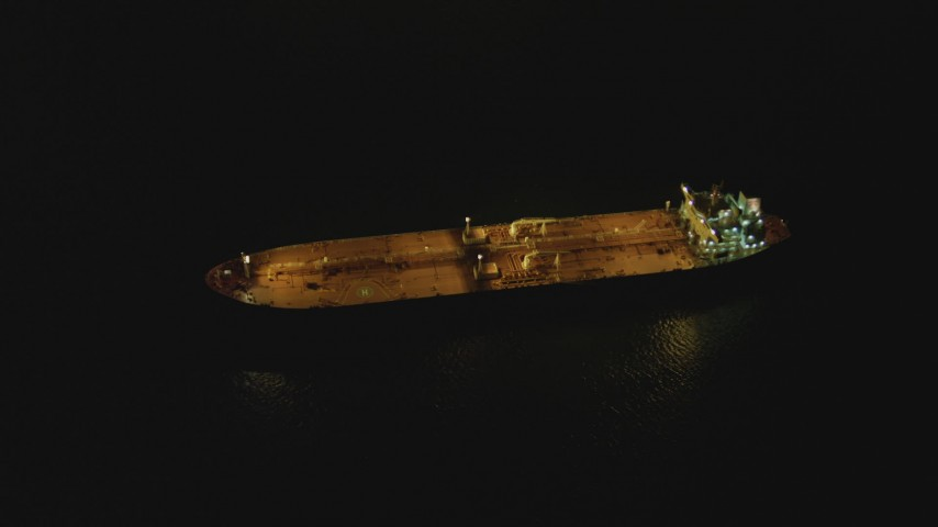4K stock footage aerial video of an orbit of an oil tanker sailing near Port of Long Beach, California, night Aerial Stock Footage | DCA07_148